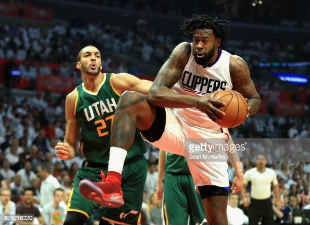 DeAndre Jordan of the Los Angeles Clippers rebounds the ball from Rudy Gobert of the Utah Jazz during the first half of Game Seven of the Western...