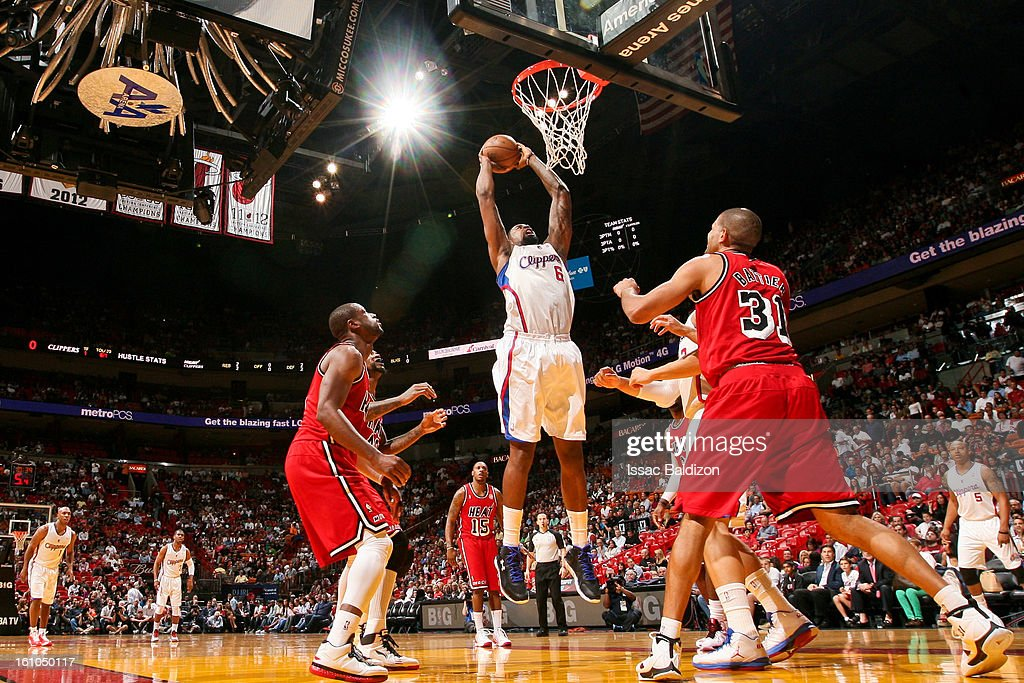 <a gi-track='captionPersonalityLinkClicked' href=/galleries/search?phrase=DeAndre+Jordan&family=editorial&specificpeople=4665718 ng-click='$event.stopPropagation()'>DeAndre Jordan</a> #6 of the Los Angeles Clippers rises for a dunk against the Miami Heat on February 8, 2013 at American Airlines Arena in Miami, Florida.