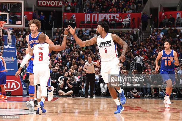 DeAndre Jordan of the Los Angeles Clippers shakes hands with Chris Paul of the Los Angeles Clippers during the game against the New York Knicks on...