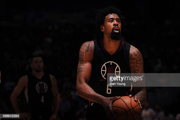 DeAndre Jordan of the Los Angeles Clippers shoots a free throw against the Denver Nuggets on November 24 2015 at the Pepsi Center in Denver Colorado...
