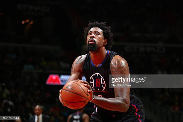 DeAndre Jordan of the Los Angeles Clippers shoots a free throw against the Washington Wizardson December 28 2015 at Verizon Center in Washington DC...