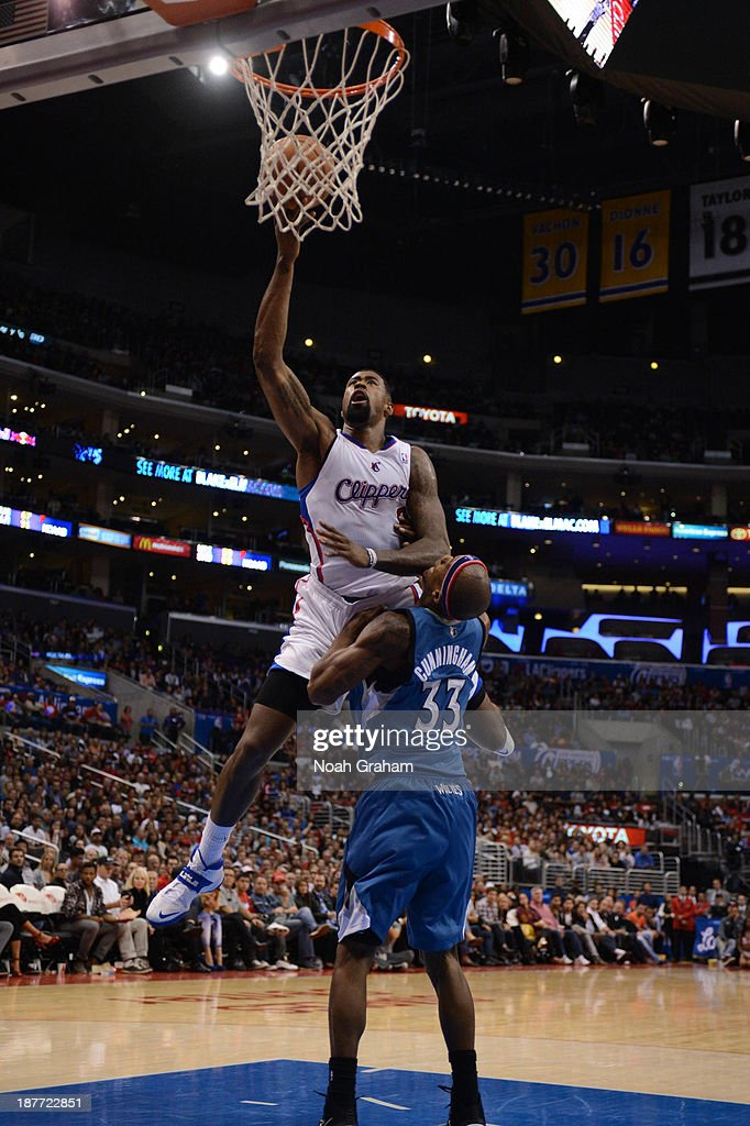 <a gi-track='captionPersonalityLinkClicked' href=/galleries/search?phrase=DeAndre+Jordan&family=editorial&specificpeople=4665718 ng-click='$event.stopPropagation()'>DeAndre Jordan</a> #6 of the Los Angeles Clippers shoots against <a gi-track='captionPersonalityLinkClicked' href=/galleries/search?phrase=Dante+Cunningham&family=editorial&specificpeople=683729 ng-click='$event.stopPropagation()'>Dante Cunningham</a> #33 of the Minnesota Timberwolves at Staples Center on November 11, 2013 in Los Angeles, California.