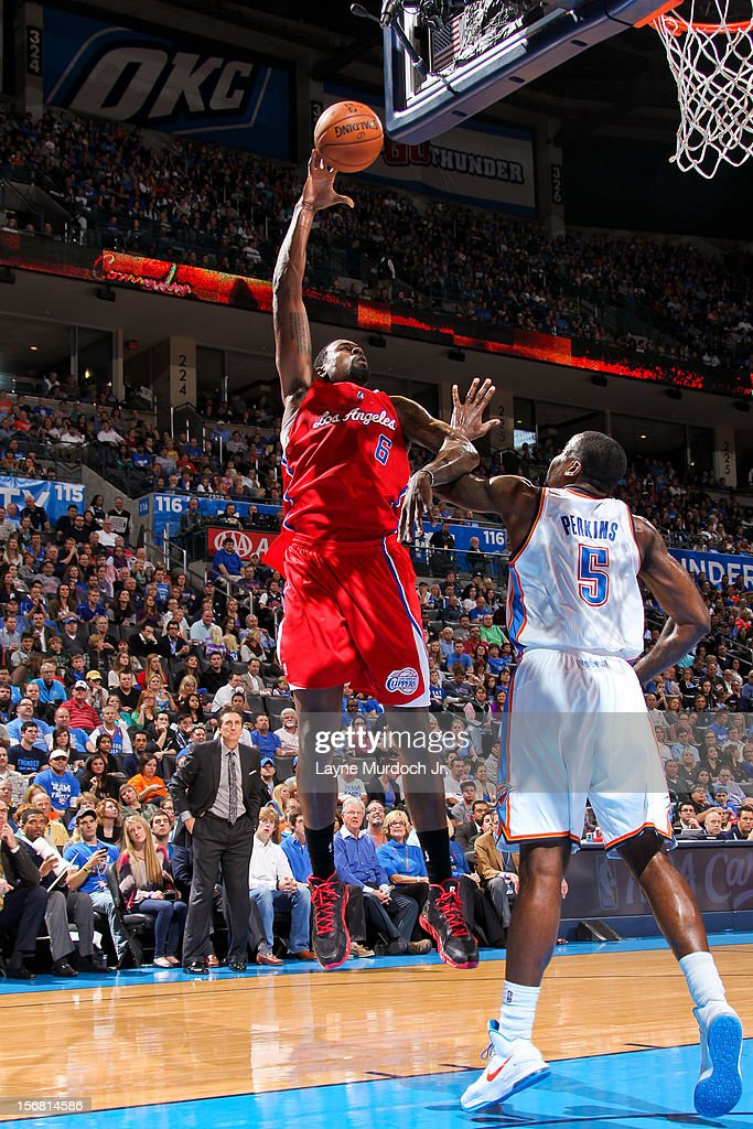 DeAndre Jordan #6 of the Los Angeles Clippers shoots against Kendrick Perkins #5 of the Oklahoma City Thunder on November 21, 2012 at the Chesapeake Energy Arena in Oklahoma City, Oklahoma.