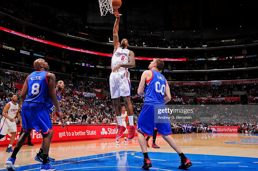 DeAndre Jordan #6 of the Los Angeles Clippers shoots in the lane against Spencer Hawes #00 of the Philadelphia 76ers at Staples Center on March 20, 2013 in Los Angeles, California.