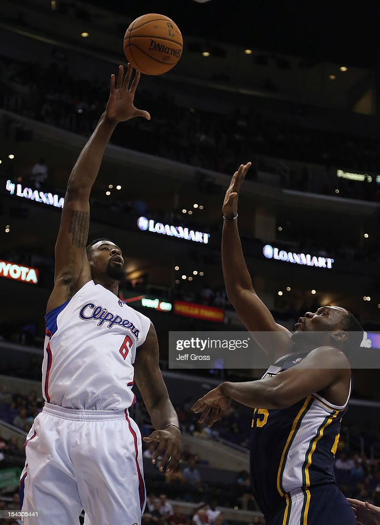 <a gi-track='captionPersonalityLinkClicked' href=/galleries/search?phrase=DeAndre+Jordan&family=editorial&specificpeople=4665718 ng-click='$event.stopPropagation()'>DeAndre Jordan</a> #6 of the Los Angeles Clippers shoots over <a gi-track='captionPersonalityLinkClicked' href=/galleries/search?phrase=Al+Jefferson&family=editorial&specificpeople=201604 ng-click='$event.stopPropagation()'>Al Jefferson</a> #25 of the Utah Jazz during the first half of a preseason game at Staples Center on October 17, 2012 in Los Angeles, California. The Clippers defeated the Jazz 96-94.