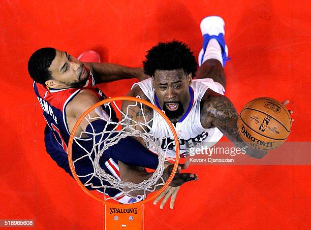 DeAndre Jordan of the Los Angeles Clippers shoots over Garrett Temple of the Washington Wizards during the first half of the basketball game at...