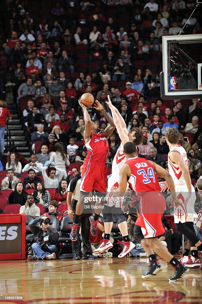 DeAndre Jordan #6 of the Los Angeles Clippers shoots the ball over Omer Asik #3 of the Houston Rockets on January 15, 2013 at the Toyota Center in Houston, Texas.
