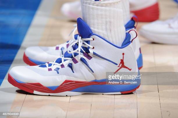 DeAndre Jordan of the Los Angeles Clippers showcases his sneakers against the Houston Rockets at Staples Center on November 4 2013 in Los Angeles...