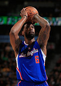 DeAndre Jordan of the Los Angeles Clippers takes a free throw against the Denver Nuggets at Pepsi Center on December 19 2014 in Denver Colorado The...