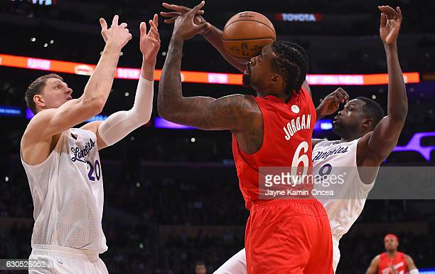 DeAndre Jordan of the Los Angeles Clippers Timofey Mozgov and Luio Deng of the Los Angeles Lakers go for a rebound in the first quarter of the game...