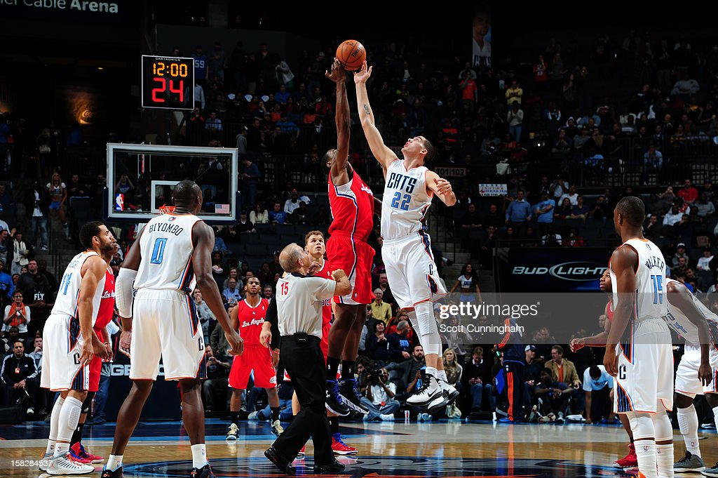 DeAndre Jordan #6 of the Los Angeles Clippers tips off against Byron Mullens #22 of the Charlotte Bobcats at Time Warner Cable Arena on December 12, 2012 in Charlotte, North Carolina.