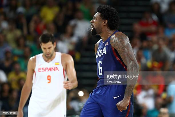 DeAndre Jordan of United States celebrates a dunk as Felipe Reyes of Spain looks on during the Men's Semifinal match on Day 14 of the Rio 2016...