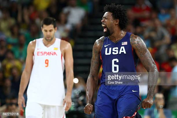 DeAndre Jordan of United States celebrates a play as Felipe Reyes of Spain looks on during the Men's Semifinal match on Day 14 of the Rio 2016...