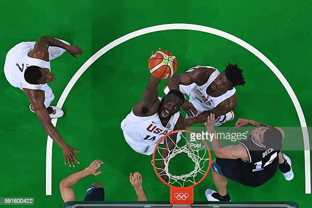 DeAndre Jordan of United States grabs a rebound against Argentina during the Men's Quarterfinal match on Day 12 of the Rio 2016 Olympic Games at...