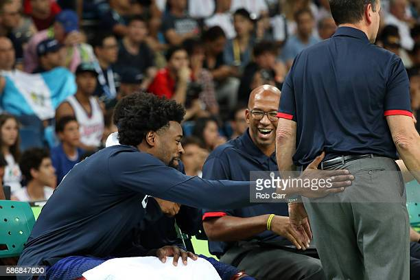 DeAndre Jordan of United States pats head coach Mike Krzyewski from behind during the game against China on Day 1 of the Rio 2016 Olympic Games at...