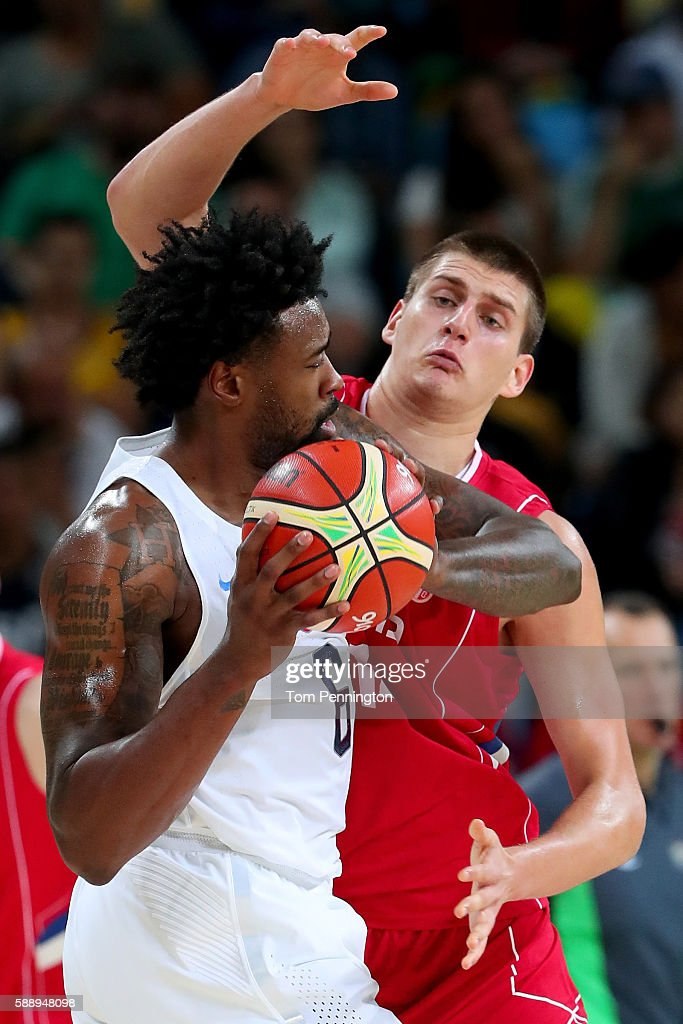 DeAndre Jordan #6 of United States with the ball against Nikola Jokic #14 of Serbia in the Men's Preliminary Round Group A match on Day 7 of the Rio 2016 Olympic Games at Carioca Arena 1 on August 12, 2016 in Rio de Janeiro, Brazil.