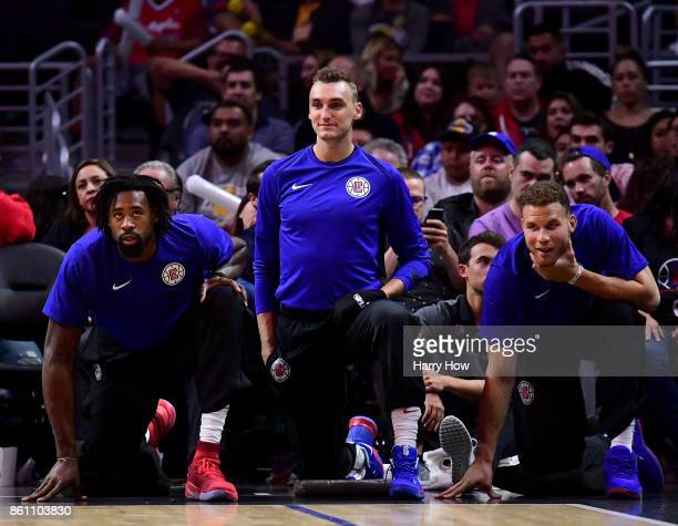 DeAndre Jordan Sam Dekker and Blake Griffin of the LA Clippers look on during a 111104 loss to the Los Angeles Lakers at Staples Center on October 10...