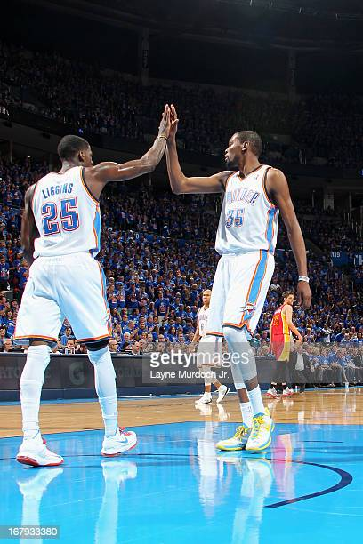 DeAndre Liggins and Kevin Durant of the Oklahoma City Thunder celebrate a play against the Houston Rockets in Game Five of the Western Conference...