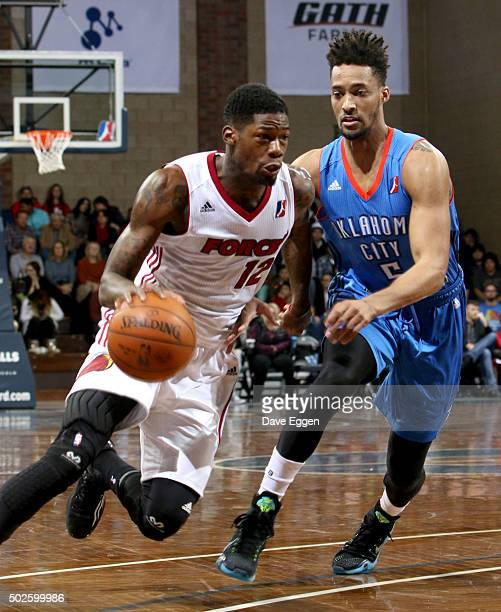 DeAndre Liggins from the Sioux Falls Skyforce drives against JeanPierre Tokoto from the Oklahoma City Blue at the Sanford Pentagon December 25 2015...