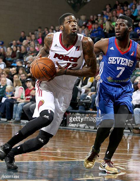 DeAndre Liggins from the Sioux Falls Skyforce drives past Rysheed Jordan from the Delaware 87ers at the Sanford Pentagon December 5 2015 in Sioux...