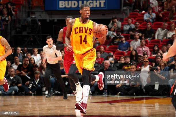 DeAndre Liggins of the Cleveland Cavaliers brings the ball up court during the game against the Miami Heat on March 4 2017 at AmericanAirlines Arena...
