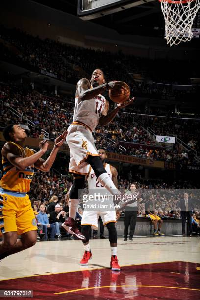 DeAndre Liggins of the Cleveland Cavaliers grabs the rebound against the Denver Nuggets on February 11 2017 at Quicken Loans Arena in Cleveland Ohio...