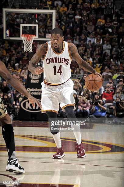 DeAndre Liggins of the Cleveland Cavaliers handles the ball against the Milwaukee Bucks on December 21 2016 at Quicken Loans Arena in Cleveland Ohio...