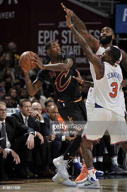 DeAndre Liggins of the Cleveland Cavaliers looks to passes the ball against the New York Knicks on October 25 2016 at Quicken Loans Arena in...