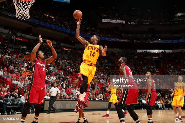 DeAndre Liggins of the Cleveland Cavaliers shoots the ball during the game against the Miami Heaton March 4 2017 at AmericanAirlines Arena in Miami...