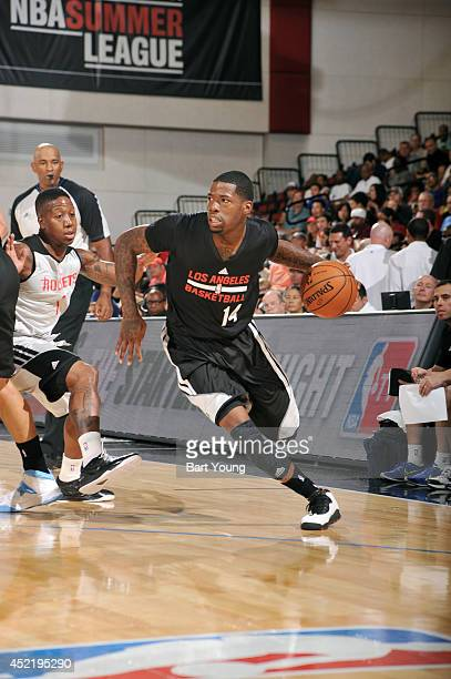 DeAndre Liggins of the Los Angeles Clippers drives against the Houston Rockets during the Samsung NBA Summer League 2014 on July 15 2014 at the Cox...