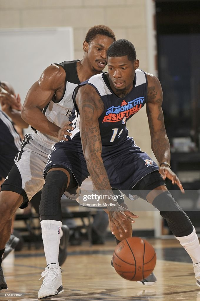 DeAndre Liggins #14 of the Oklahoma City Thunder drives under pressure during the 2013 Southwest Airlines Orlando Pro Summer League game between the Oklahoma City Thunder and the Houston Rockets on July 12, 2013 at Amway Center in Orlando, Florida.