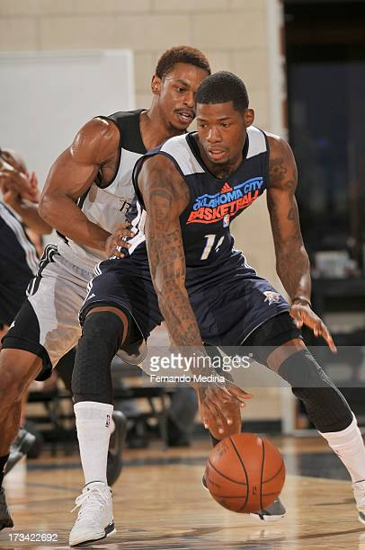 DeAndre Liggins of the Oklahoma City Thunder drives under pressure during the 2013 Southwest Airlines Orlando Pro Summer League game between the...