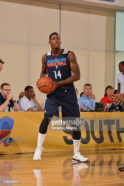 DeAndre Liggins of the Oklahoma City Thunder looks to pass against the Philadelphia 76ers during the 2013 Southwest Airlines Orlando Pro Summer...