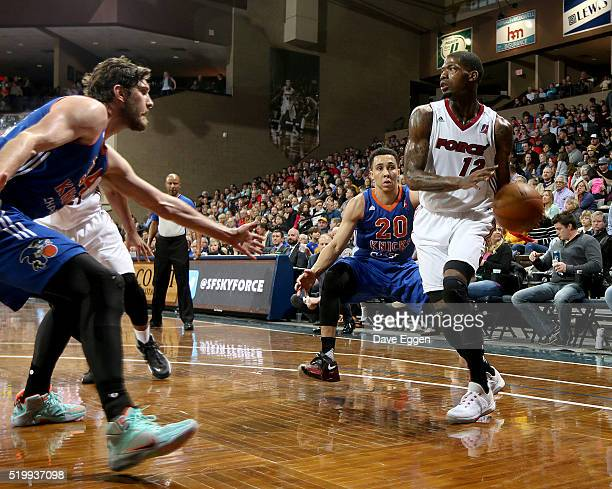 DeAndre Liggins of the Sioux Falls Skyforce looks for a teammate around Jordan Bachynski and Travis Trice II from the Westchester Knicks during their...