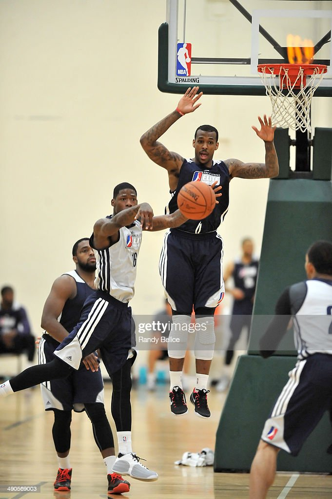 DeAndre Liggins #16 of the Sioux Falls Skyforce throws a pass in front of Gilbert Brown #18 of the Canton Charge on day two of the 2014 NBA Development League Elite Mini Camp on May 13, 2014 at Quest Multisport in Chicago, Illinois.