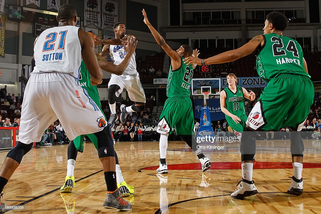 <a gi-track='captionPersonalityLinkClicked' href=/galleries/search?phrase=DeAndre+Liggins&family=editorial&specificpeople=5590638 ng-click='$event.stopPropagation()'>DeAndre Liggins</a> #24 of the Tulsa 66ers goes passes the ball against the Idaho Stampede during an NBA D-League game on March 16, 2013 at CenturyLink Arena in Boise, Idaho. The Stampede wore green jerseys for a St. Patrick's Day-related fundraiser. Liggins was on assignment from the Oklahoma City Thunder.