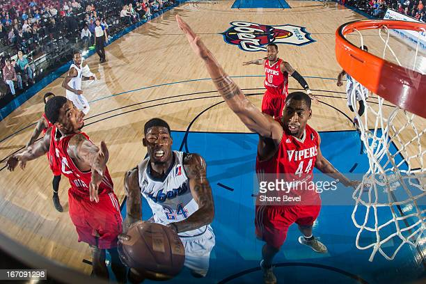 DeAndre Liggins of the Tulsa 66ers goes up for the layup against Chris Daniels of the Rio Grande Vipers during the NBA DLeague playoff game on April...
