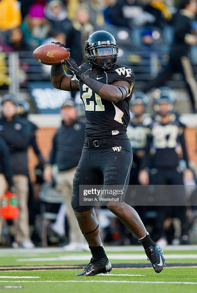 Deandre Martin #21 of the Wake Forest Demon Deacons thinks about passing the ball during first quarter action against the Vanderbilt Commodores at BB&T Field on November 24, 2012 in Winston Salem, North Carolina. The Commodores defeated the Demon Deacons 55-21.