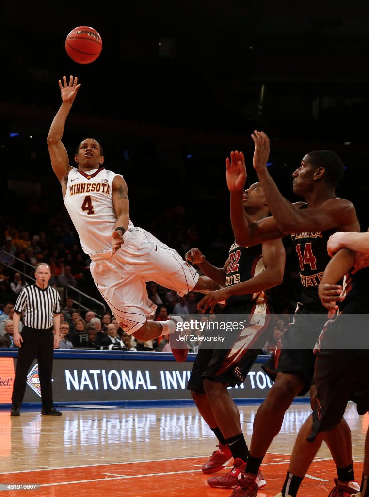 Deandre Mathieu #4 of the Minnesota Golden Gophers shoots next to Montay Brandon #32 of the Florida State Seminoles during the NIT Championship semifinals at Madison Square Garden on April 1, 2014 in New York City.