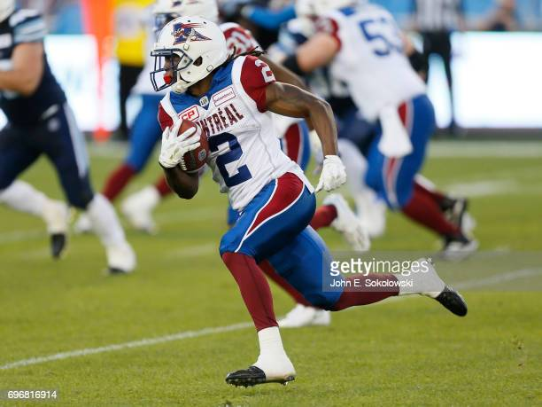 Deandre Reaves of the Montreal Alouettes returns a kick against the # of the Toronto Argonauts during a CFL preseason game at BMO field on June 8...