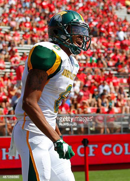 DeAndre Sangster of the Norfolk State Spartans celebrates his touchdown catch against the Rutgers Scarlet Knights during the first half in a game at...