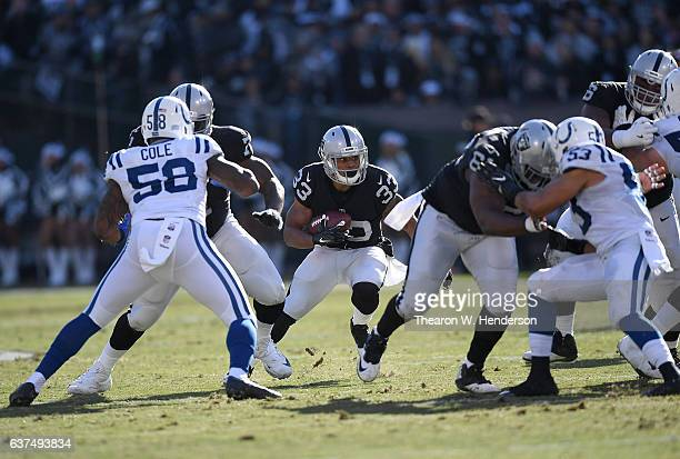 DeAndre Washington of the Oakland Raiders carries the ball against the Indianapolis Colts during the first quarter of their NFL football game at the...