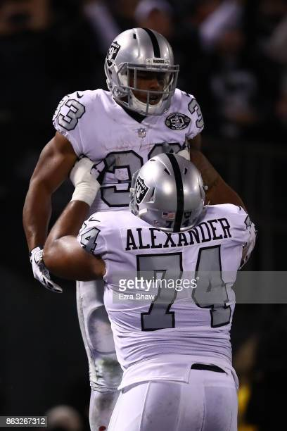 DeAndre Washington of the Oakland Raiders celebrates after a touchdown with Vadal Alexander during their NFL game against the Kansas City Chiefs at...