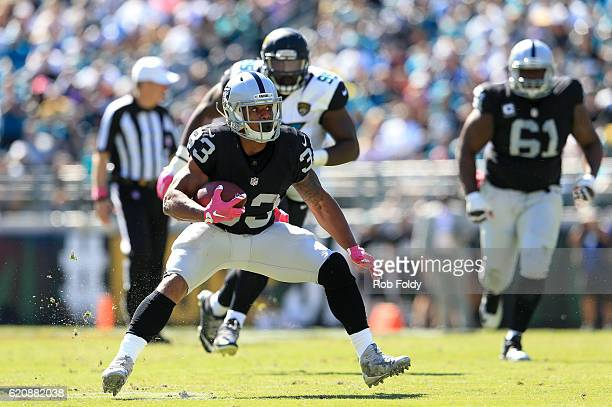 DeAndre Washington of the Oakland Raiders in action during the game against the Jacksonville Jaguars at EverBank Field on October 23 2016 in...