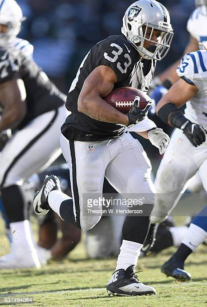 DeAndre Washington of the Oakland Raiders rushes for a 22 yard touchdown run against the Indianapolis Colts during the third quarter of their NFL...