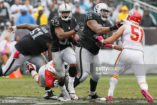 DeAndre Washington of the Oakland Raiders rushes with the ball against the Kansas City Chiefs during their NFL game at OaklandAlameda County Coliseum...