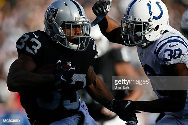 DeAndre Washington of the Oakland Raiders rushes with the ball against the Indianapolis Colts during their NFL game at Oakland Alameda Coliseum on...