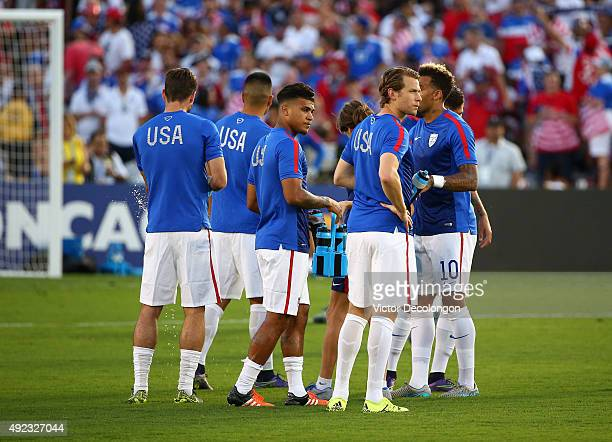 DeAndre Yedlin and Jonathan Spector of the United States take a water break with teammates during training prior to the 2017 FIFA Confederations Cup...