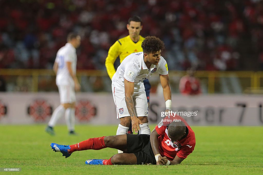 <a gi-track='captionPersonalityLinkClicked' href=/galleries/search?phrase=DeAndre+Yedlin&family=editorial&specificpeople=10292103 ng-click='$event.stopPropagation()'>DeAndre Yedlin</a> #2 apologises to T&T's <a gi-track='captionPersonalityLinkClicked' href=/galleries/search?phrase=Khaleem+Hyland&family=editorial&specificpeople=5366394 ng-click='$event.stopPropagation()'>Khaleem Hyland</a> #8 during a World Cup Qualifier between Trinidad and Tobago and USA as part of the FIFA World Cup Qualifiers for Russia 2018 at Hasely Crawford Stadium on November 17, 2015 in Port of Spain, Trinidad & Tobago.