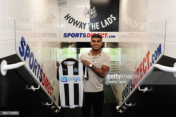 DeAndre Yedlin holds a club shirt in the tunnel after signing a 5 year contract at StJames' Park on August 24 in Newcastle upon Tyne England